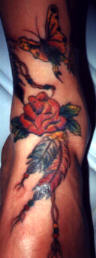 Roses and butterfly foot tattoo